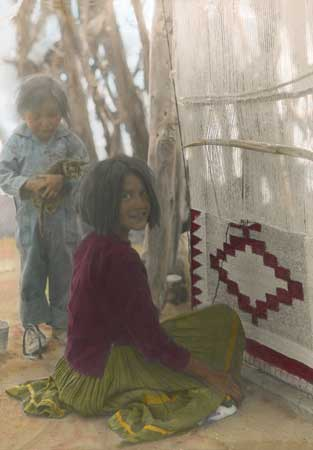 navajo girl at loom